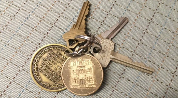 Residents receive keys upon graduating from the recovery home